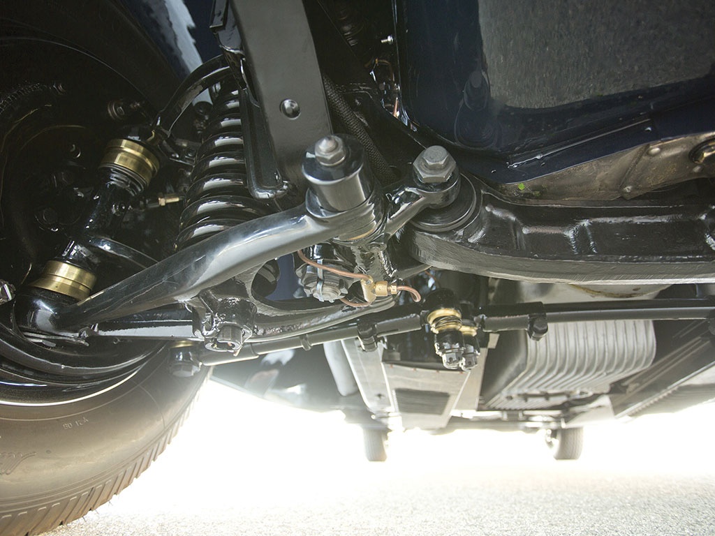 Front suspension is modern with double A arms, coil springs and telescopic shock absorbers.