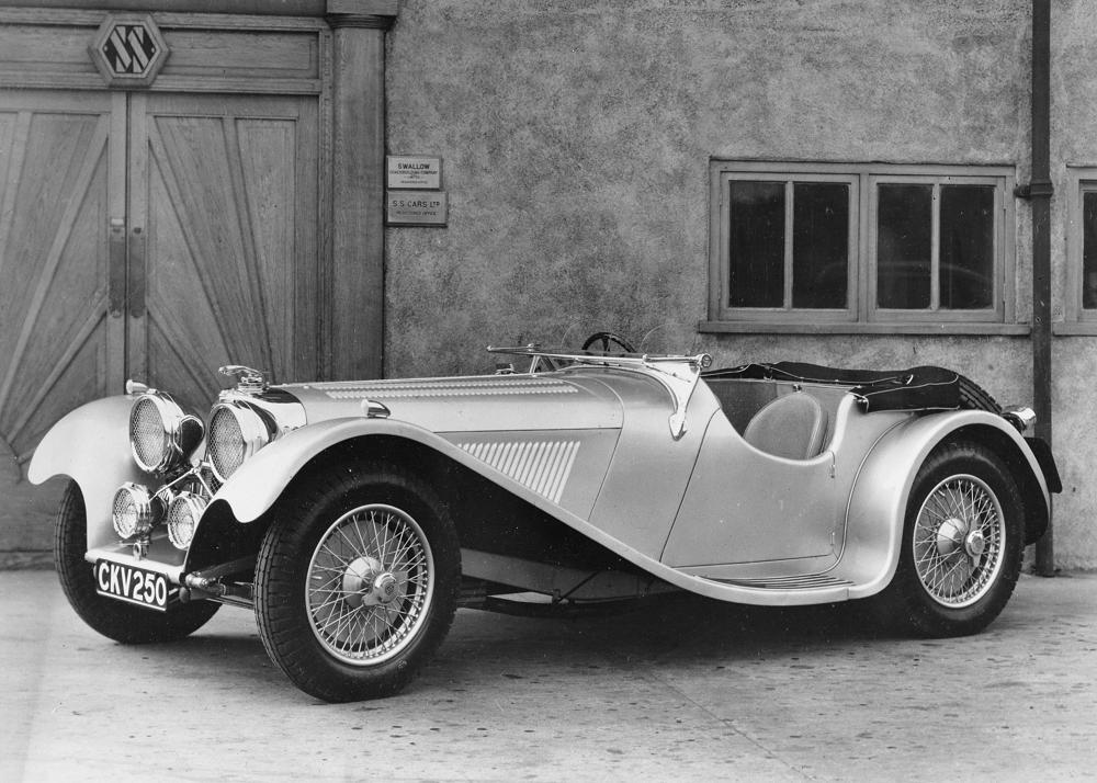 "Car registration number CKV250 was the first recorded SS car to wear the ""leaping Jaguar"" mascot.  It is seen here in 1937 outside the SS Cars factory which would become Jaguar Cars after the Second World War in 1945. (Picture courtesy Wikipedia)."