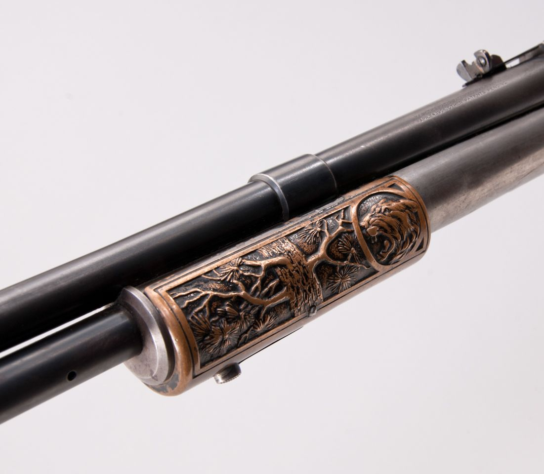 The decoration of the slide handle on the left side features a tree and a lion, whilst on the right side are a tree and a moose. (Picture courtesy icollector.com).