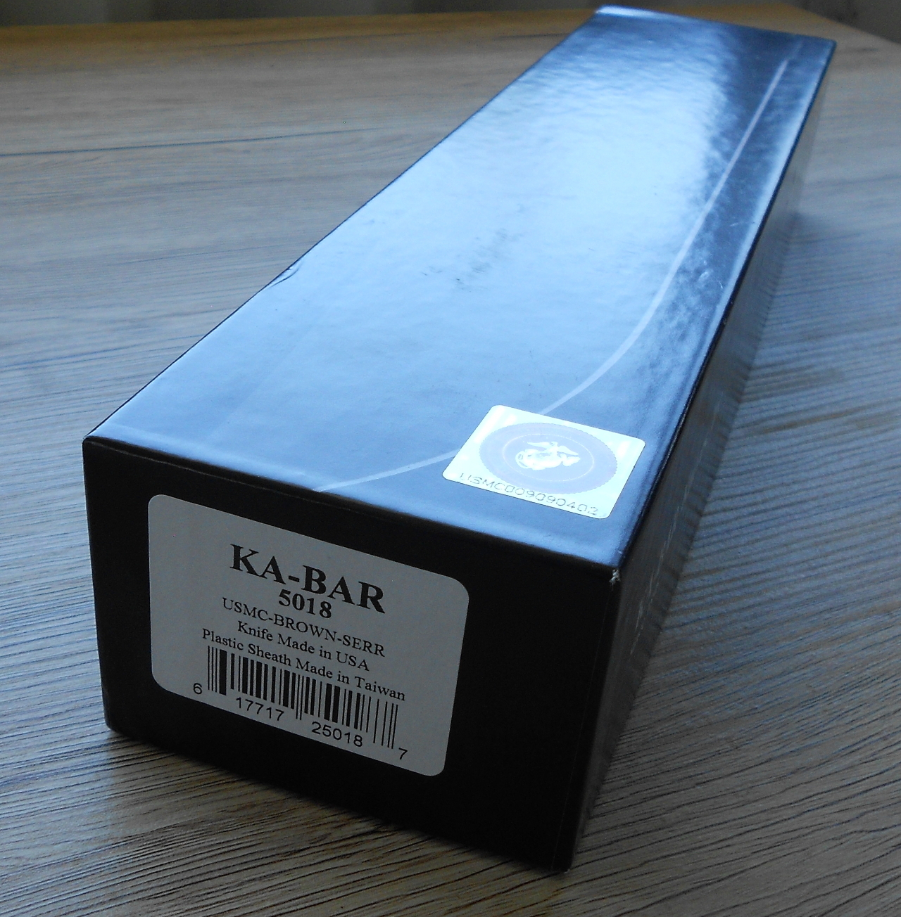 "A genuine USMC Ka-Bar is marked on the box as ""Knife Made in USA"" and has a numbered hologram sticker on the top corner."