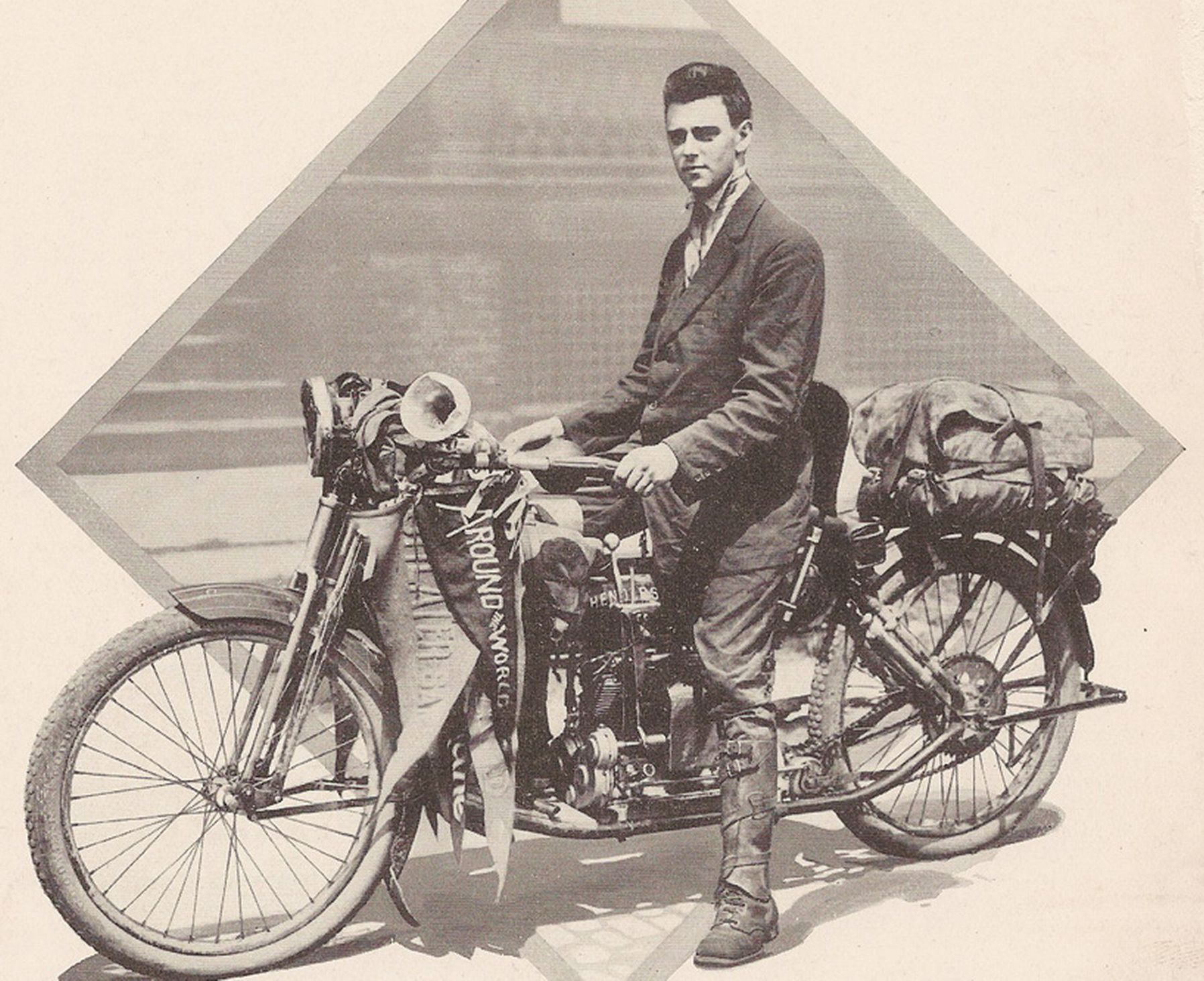 Carl Stearns Clancy on his 1912 Henderson Four at the successful conclusion of his around the world trip. This was the first around the world motorcycle journey ever accomplished. (Picture courtesy Wikipedia).
