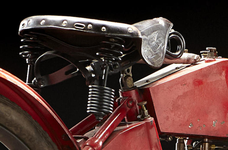 "New for 1912 was the Harley-Davidson ""Ful-Floteing Seat"". As can be seen the seat is suspended at three points; by a coil spring in the seat tube, and by two coil spring supports at the rear."