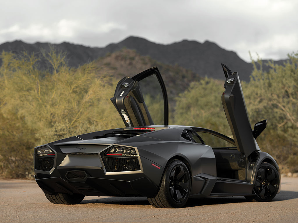 "With its signature Lamborghini scissor doors the Reventón looks like it should be able to lift off and fly just like Doc's DeLorean time machine in ""Back to the Future""."