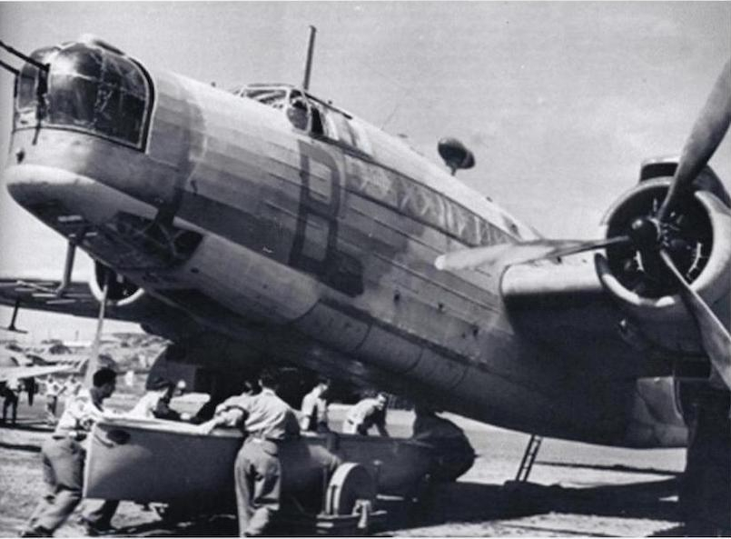 loading a lifeboat under a bomber