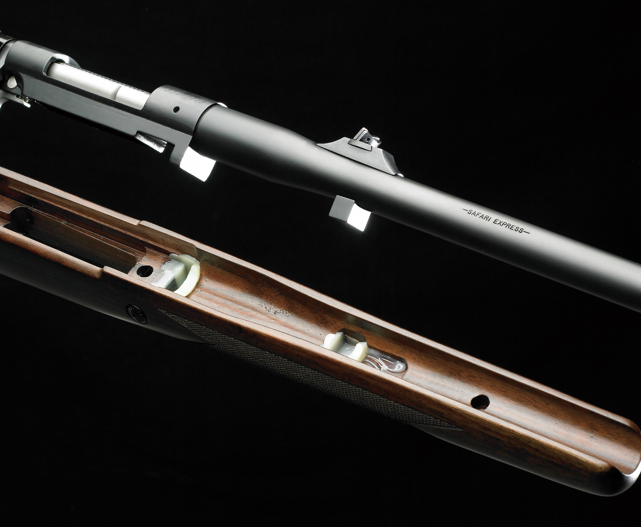 Twin recoil lug bedding system for the Winchester Model 70 Safari Express rifle