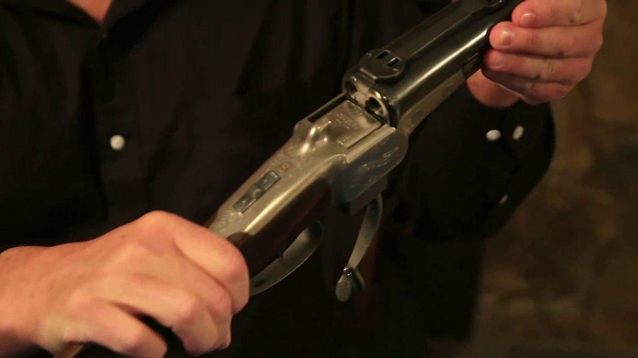 Kalezky falling block double rifle open breech